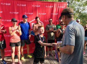 Kid receives medal