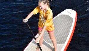 Girl on standup paddle board