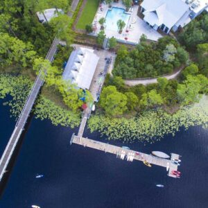 Aerial view of the boathouse paddle club showing dock, kayaks, and paddle boards