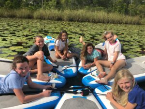 Happy girls relaxing on paddleboards
