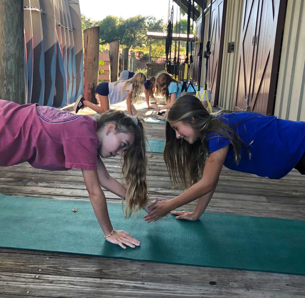 Girls on mats working out