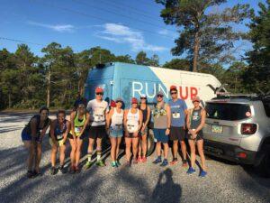 people in front of RUNSUP van